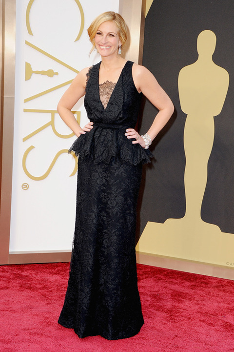 Julia Roberts tried, but this severe black dress with pasted on doilies was awkward and did not mesh well with her newly blonde hair.