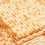 14638324-Matzo-or-matzah-is-bread-traditionally-eaten-by-Jews-during-the-week-long-Passover-holiday-Stock-Photo